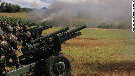 Philippine troops fire their 105mm howitzer cannons towards enemy positions from their base near Butig town in Lanao del Sur province on the southern island of Mindanao on November 27, 2016. Troops on November 27 fired artillery at positions held by an Islamic militant faction in the southern Philippines as more soldiers deployed against the group, which staged a deadly bombing in President Rodrigo Duterte's home city. / AFP / RICHEL UMEL        (Photo credit should read RICHEL UMEL/AFP/Getty Images)