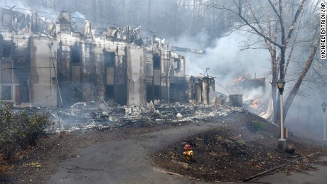 Two of the dormitories at Arrowmont School are damaged from the wildfires around Gatlinburg, Tenn., on Tuesday, Nov. 29, 2016.  Rain had begun to fall in some areas, but experts predicted it would not be enough to end the relentless drought that has spread across several Southern states and provided fuel for fires now burning for weeks in states including Tennessee, Georgia and North Carolina. (Michael Patrick/Knoxville News Sentinel via AP