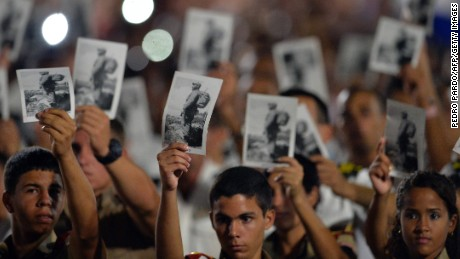 People participate in a massive rally at Revolution Square in Havana in honor of late leader Fidel Castro.Castro -- who ruled from 1959 until an illness forced him to hand power to his brother Raul in 2006 -- died Friday at age 90. The cause of death has not been announced. / AFP PHOTO / PEDRO PARDOPEDRO PARDO/AFP/Getty Imag