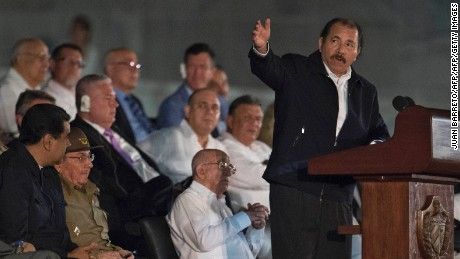 Nicaraguan President Daniel (R) Ortega gestures as he delivers a speech next to Cuban President Raul Castro (3-L), Venezuela's President Nicolas Maduro (2-L) and Venezuelan First Lady Cilia Flores, during a massive rally at Revolution Square in Havana in honor of Cuban late leader Fidel Castro. Castro -- who ruled from 1959 until an illness forced him to hand power to his brother Raul in 2006 -- died Friday at age 90. The cause of death has not been announced. / AFP / JUAN BARRETO        (Photo credit should read JUAN BARRETO/AFP/Getty Images)