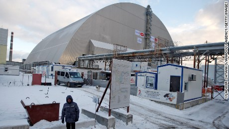 The new protective shield enclosing Chernobyl's damaged reactor was pushed into position Tuesday.