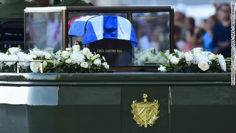 An urn containing the ashes of Fidel Castro is driven through Havana on Wednesday, starting a four-day journey across Cuba.