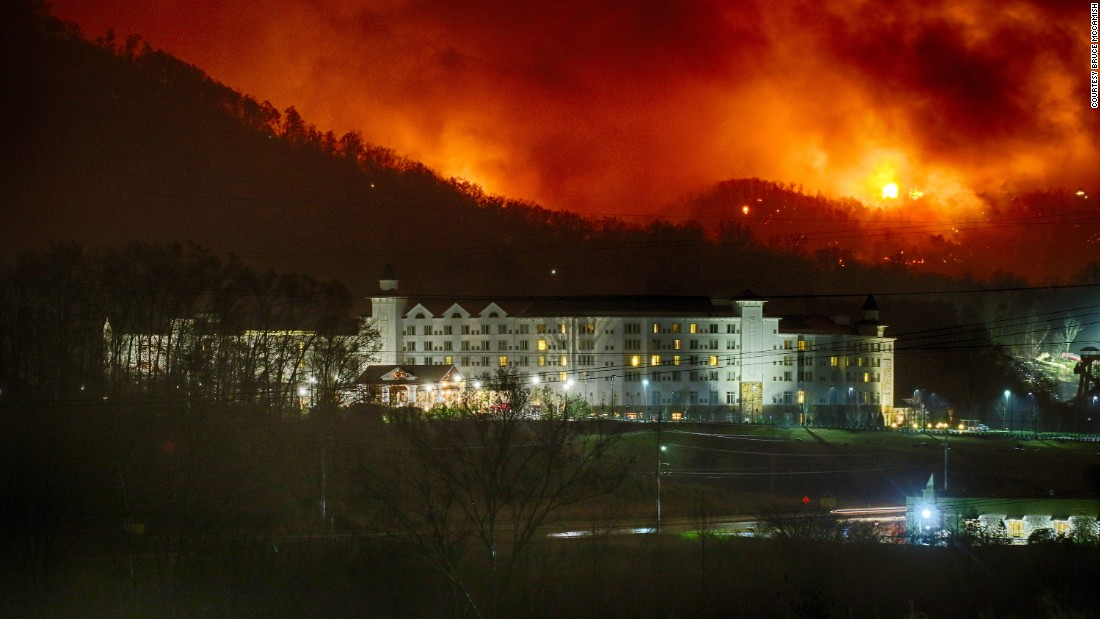 Photographer Bruce McCamish captured this image of the fires burning behind the Dollywood Dreammore Resort in Pigeon Forge, Tennessee.