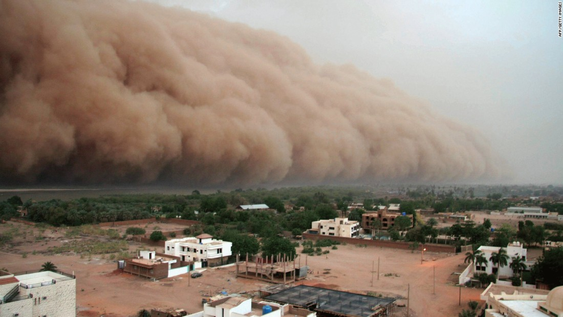 "A gigantic cloud of dust known as ""Haboob"" advances over Sudan's capital, Khartoum. A Haboob usually occurs after a few days of rising temperatures and falling pressures and can change the landscape in the few hours it lasts by depositing enormous quantities of sand -- destroying villages and crops."