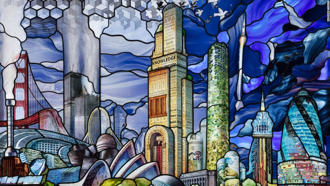 This panel depicts architectural achievements of the Twentieth Century -- the Saturn V rocket can be seen racing into the atmosphere on the right hand side.