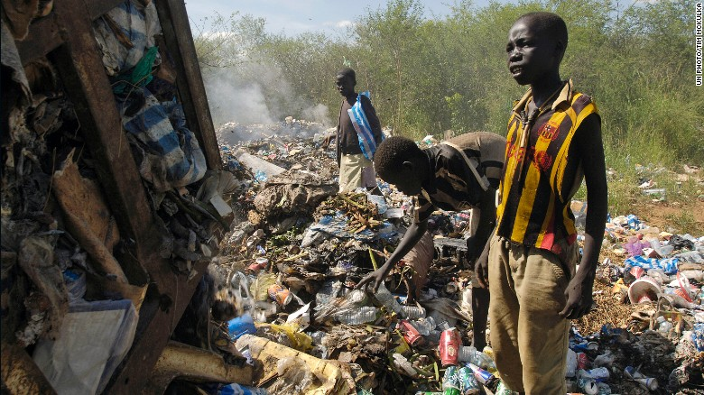 Children scavenge food and clothing from the Juba Municipal Garbage Dump.