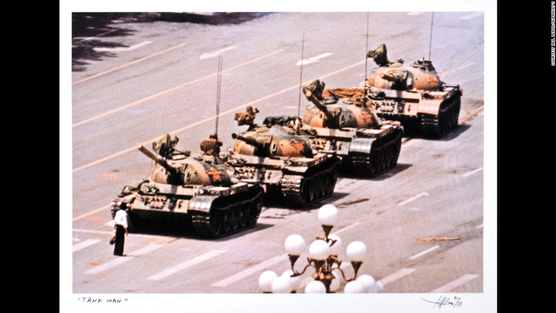 "A protester in Tiananmen Square stands in front of a column of Chinese tanks in 1989. The photo was taken by Jeff Widener. ""I never met Widener before,"" Leifer said. ""I found his email address and we talked a bit. At some point, he came to New York and I said I would love to get together. We had a drink and swapped prints. I wanted Pulitzer Prize winners in my collection; this photo was a finalist in 1990."""