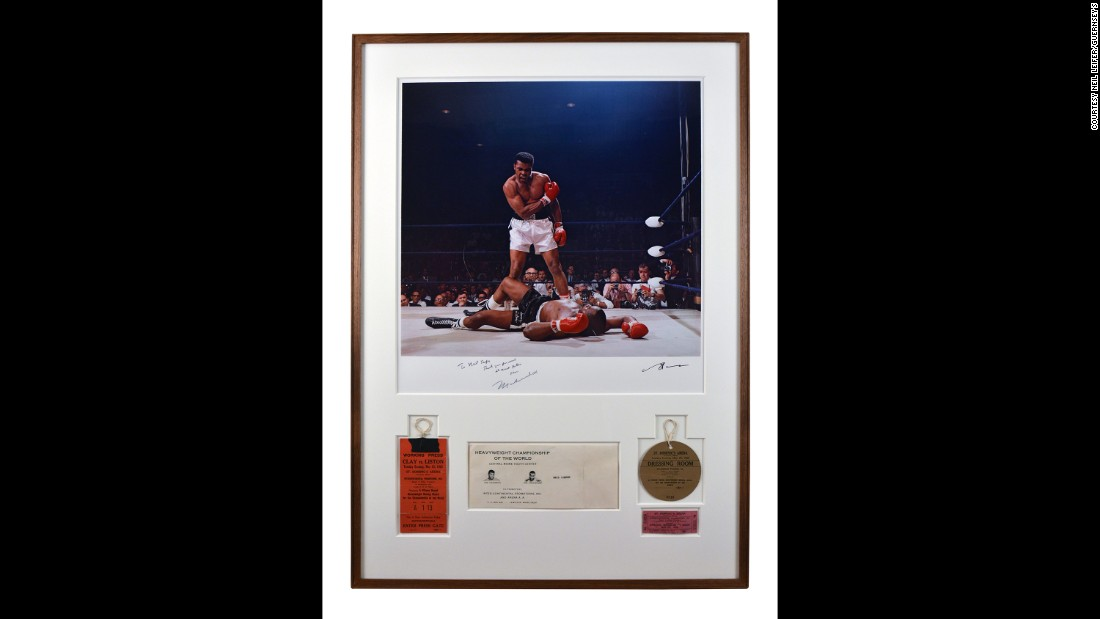 "Muhammad Ali signed this iconic Leifer photo of him standing over a fallen Sonny Liston in 1965. ""Thank you for such a great picture,"" Ali wrote. Leifer said this is ""certainly my most famous photograph. ... I love the picture, I'm very proud of it. I was in the right seat, the lucky seat, and I didn't miss!"""