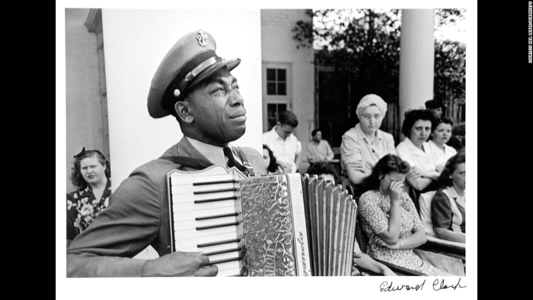 "Graham Jackson, a chief petty officer in the US Navy, plays the accordion while mourning the death of former President Franklin D. Roosevelt in 1945. ""Having grown up and studying Life magazine, I knew all the photos,"" Leifer said. ""I knew (this) Ed Clark photo, such a famous and wonderful picture."""