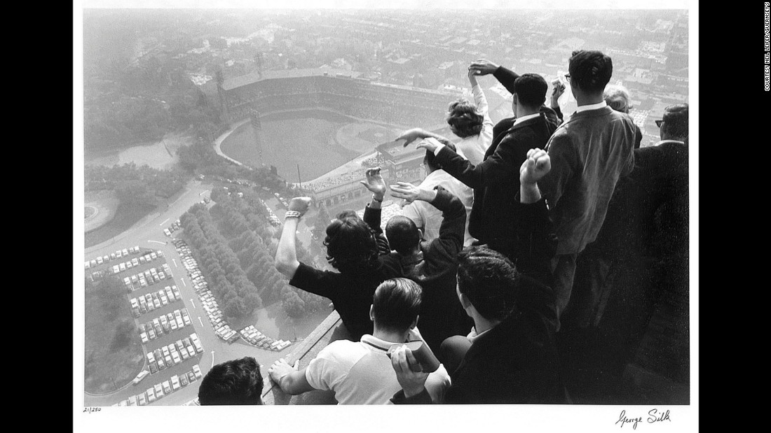 Baseball fans in Pittsburgh watch the World Series from a rooftop in 1960. George Silk was the photographer.