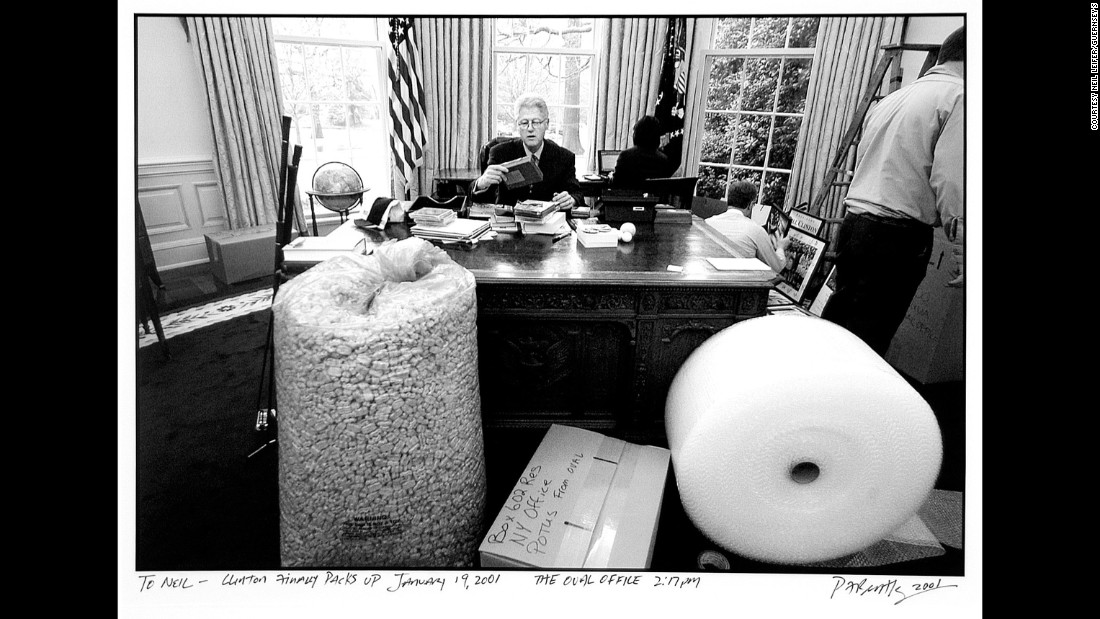 US President Bill Clinton is photographed by P.F. Bentley as he spends one of his final moments in the White House Oval Office in 2001.