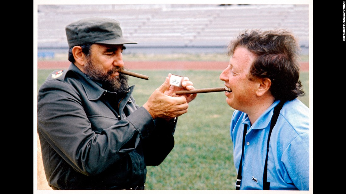 "Cuban leader Fidel Castro lights Leifer's cigar in 1984. This photo is not part of the auction. ""We did a pre-Olympic photo essay for Time magazine,"" Leifer recalled. ""The idea was to shoot photographs of top athletes from all around the world from each country -- potential Gold Medal winners. The idea was to photograph them in front of (a) picture postcard of their country. The front of the magazine was Carl Lewis. I photographed him in front of the Statue of Liberty. I went to the Cubans and said I would like to do one of the great Cuban athletes ... a boxer named Teofilo Stevenson. ... Unlike the other countries, the picture postcard of Cuba was Fidel Castro. They eventually approved the shoot. For years, I have always ended every session with a photograph of me and the subject. One day you get older and you want to look back at this sort of thing. I asked Fidel Castro when we finished our shoot, 'Can I get a picture with you?' When he was ready to pose, I said: 'I've got a particular picture in mind. I would love to have you lighting my cigar.' """