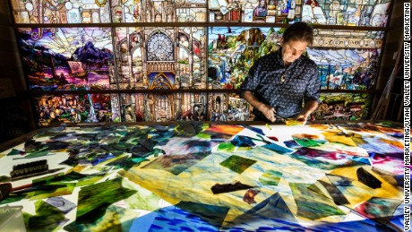"Artist Tom Holdman at work in his studio. Holdman spent over a decade working on ""Roots of Knowledge"""