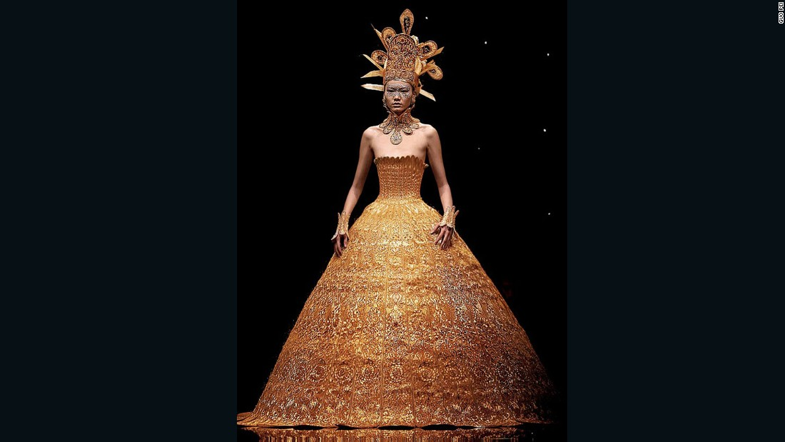 "This beaming golden dress was featured inside the Metropolitan Museum of Art's <a href=""http://www.metmuseum.org/exhibitions/listings/2015/china-through-the-looking-glass"" target=""_blank"">""China: Through the Looking Glass""</a> exhibition in 2015."