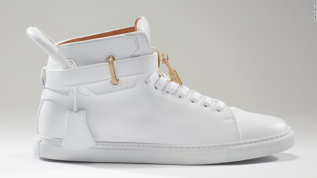 "New York-based shoe designer Jon Buscemi revealed a one-of-a-kind version of the 100m shoe -- the signature model for his eponymous label. Priced at $132,000, the leather shoe features <a href=""http://edition.cnn.com/2016/12/01/fashion/buscemi-132k-diamond-sneakers/"" target=""_blank"">diamond-encrusted embellishments</a>."