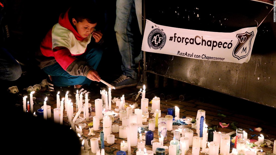People attend a candlelight vigil in Bogota, Colombia, on November 29.