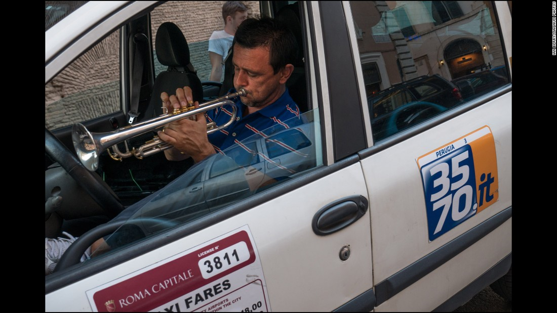 This taxi driver practices on his trumpet.