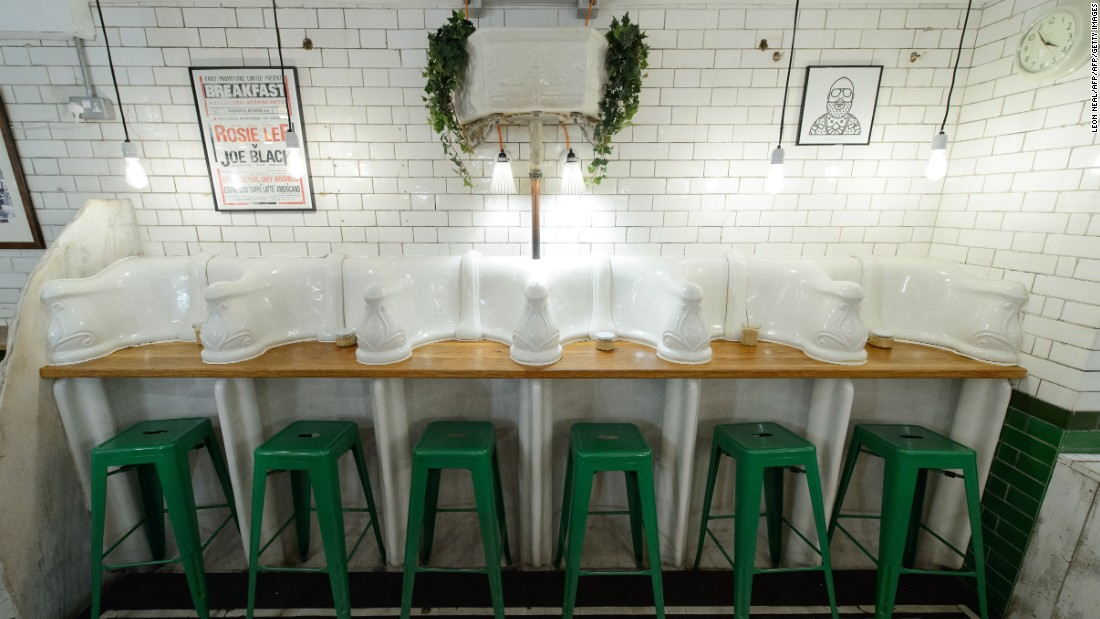 Former public toilets in London are being reinvented as coffee shops, wine bars, pizza joints -- and even homes. Here, original urinals and cisterns are pictured in Attendant, a former loo turned hip Central London coffee shop.