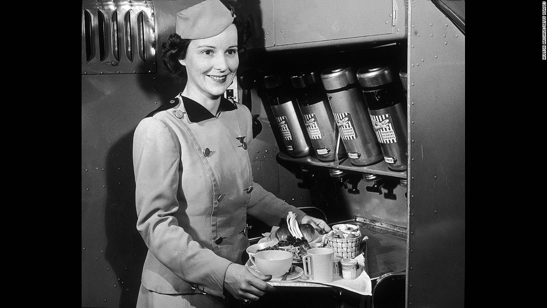 """You worked harder physically in those days,"" Nash recalls. ""We served this big meal tray."" <br />Pictured: A Canadian Colonial Airways flight attendant serves food and refreshments in the 1940s."