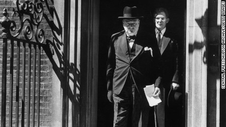 Prime Minister Winston Churchill (1874 - 1965) leaves Downing Street in London with Irish journalist and Conservative politician Brendan Bracken (1901 - 1958).   (Photo by Central Press/Getty Images)