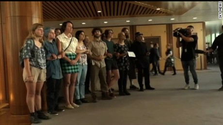 A group of protestors gather inside Australia's Parliament to protest the country's strict refugee policies on November 30.