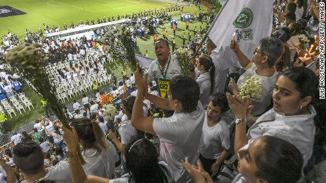 People participate in a tribute to the players of Brazilian team Chapecoense Real killed in a plane crash in the Colombian mountains, on November 29, 2016 in Medellin, Colombia.  Colombia was investigating Wednesday what made a charter plane crash into the country's northwestern mountains, killing 71 people including most of a Brazilian football team and 20 journalists. / AFP / LUIS ACOSTA        (Photo credit should read LUIS ACOSTA/AFP/Getty Images)
