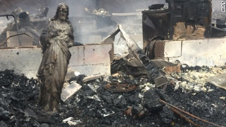 A statue of Jesus was the only thing left standing after the wildfires swept through this house in Sevier County, Tennessee.
