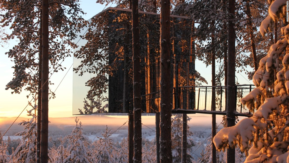 The mirrored walls of this Treehotel were designed to reflect the pristine surroundings. The base consists of an aluminum frame around the tree trunk and the interior is made from plywood with a birch surface.