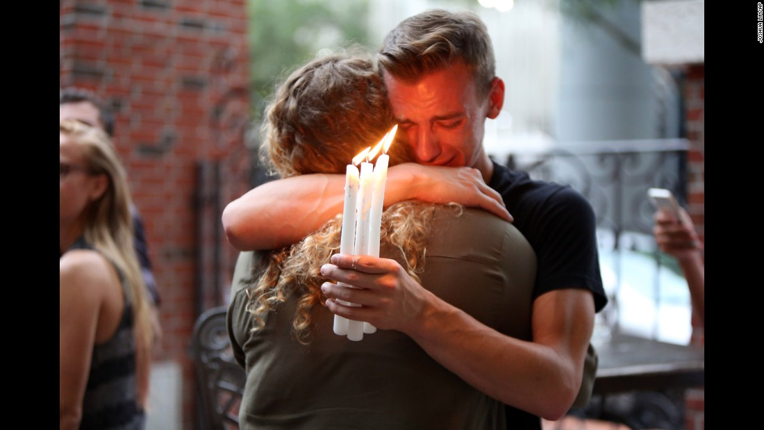 "<strong>June 12:</strong> People attend a candlelight vigil for the victims of <a href=""http://www.cnn.com/interactive/2016/06/us/cnnphotos-orlando-portraits/"" target=""_blank"">the Orlando nightclub shooting.</a> At least 49 people were killed in what was the deadliest mass shooting in US history."