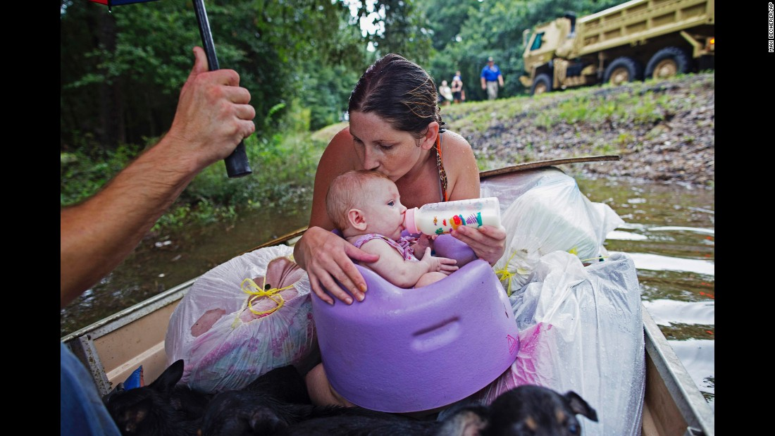"<strong>August 14:</strong> Danielle Blount and her 3-month-old baby, Ember, wait to be rescued by the Louisiana Army National Guard near Walker, Louisiana. More than 30,000 people <a href=""http://www.cnn.com/2016/08/13/us/gallery/louisiana-flooding/index.html"" target=""_blank"">were rescued in southern Louisiana</a> after heavy rains caused flooding."