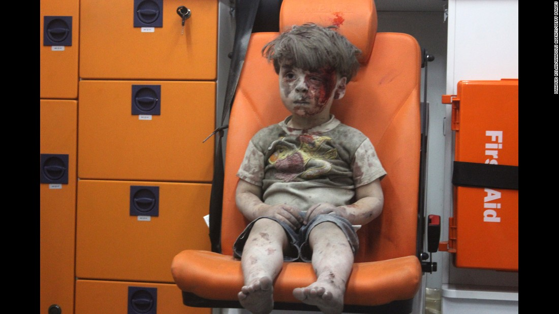 "<strong>August 17:</strong> This still image, taken from a video posted by the Aleppo Media Center, shows a young boy in an ambulance after an airstrike in Aleppo, Syria. It took nearly an hour to dig the boy, <a href=""http://www.cnn.com/2016/08/17/world/syria-little-boy-airstrike-victim/index.html"" target=""_blank"">identified as Omran Daqneesh,</a> out from the rubble, an activist told CNN. The airstrike destroyed his home, where he lived with his parents and two siblings."