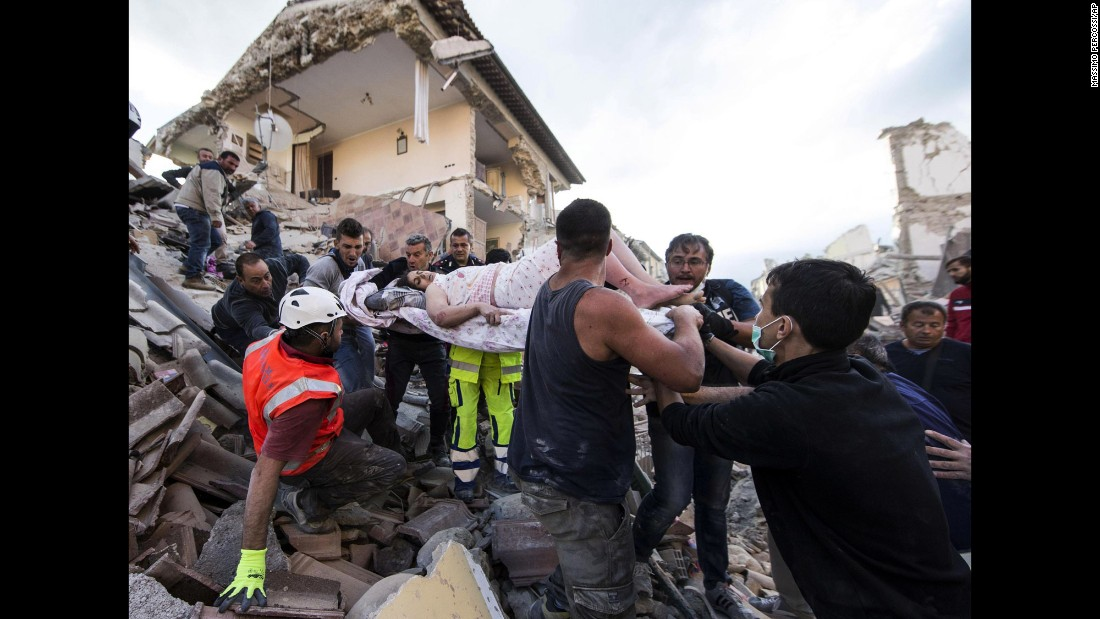 "<strong>August 24:</strong> A rescued woman is carried away on a stretcher after <a href=""http://www.cnn.com/2016/08/25/europe/italy-earthquake/"" target=""_blank"">a 6.2-magnitude earthquake</a> in Amatrice, Italy. The earthquake devastated towns across central Italy and killed more than 250 people."
