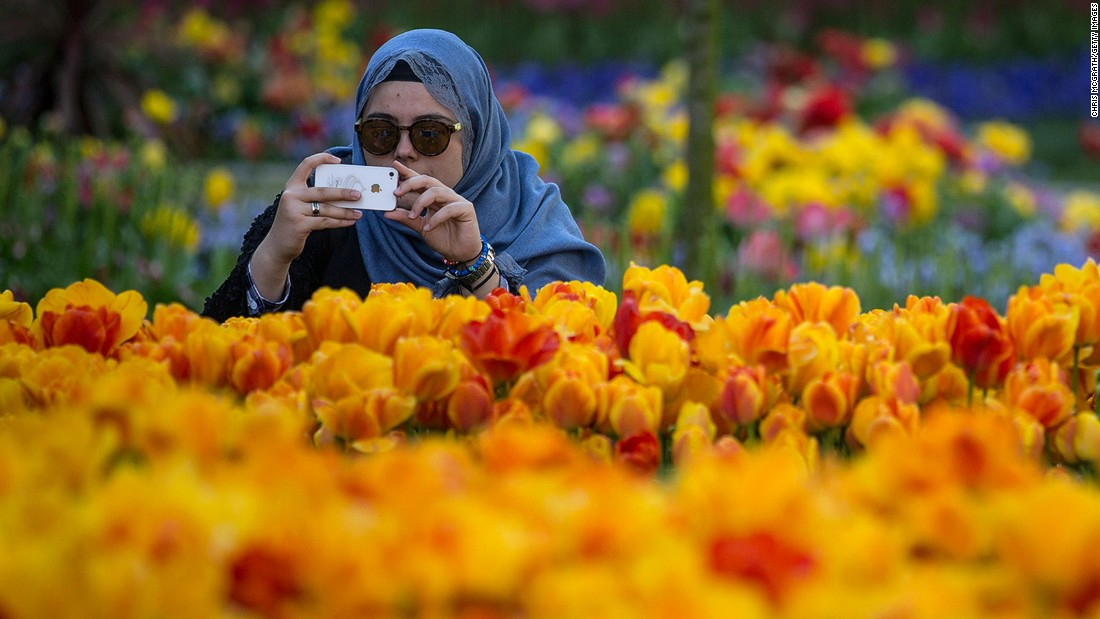 Istanbul, Turkey was in at #9 -- and may have also played a part in #turkey being named the year's most popular food hashtag. A woman snaps a picture during the city's annual Tulip Festival, held in April.