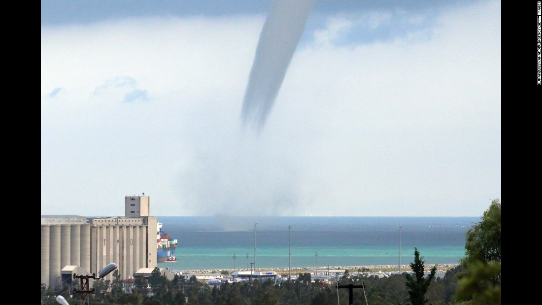 <strong>September 23:</strong> A waterspout passes near a beach in Turkey's Hatay Province.