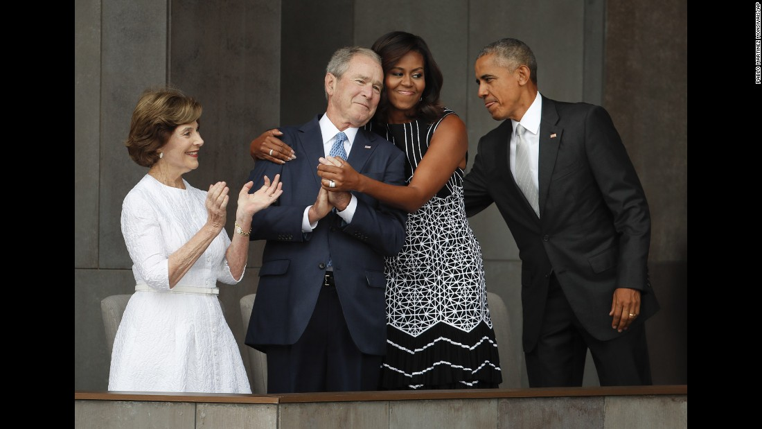 "<strong>September 24:</strong> First lady Michelle Obama hugs former US President George W. Bush during <a href=""http://www.cnn.com/2016/09/23/politics/smithsonian-african-american-museum-obama/"" target=""_blank"">the dedication ceremony</a> of the new Smithsonian museum devoted to African-American history. <a href=""http://www.cnn.com/2016/09/24/politics/michelle-obama-george-w-bush-friendship/"" target=""_blank"">The friendship of Michelle Obama and George W. Bush</a>"