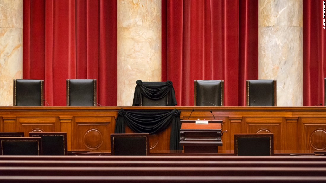 "<strong>February 16:</strong> The chair of Supreme Court Justice Antonin Scalia is draped in black in Washington. <a href=""http://www.cnn.com/2016/02/13/politics/supreme-court-justice-antonin-scalia-dies-at-79/"" target=""_blank"">He died several days earlier</a> at the age of 79."
