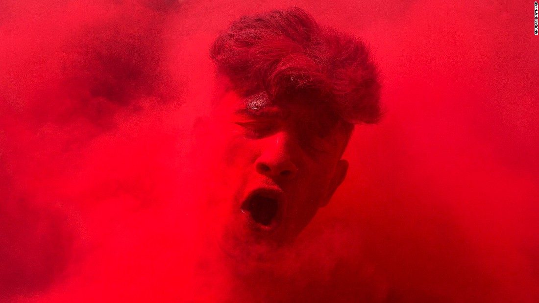 <strong>March 24:</strong> A reveler's face is smeared with colored powder as he dances during Holi celebrations in Gauhati, India. The Holi festival of colors is a Hindu celebration marking the arrival of spring.