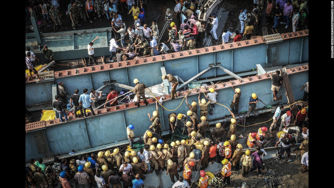 <strong>March 31: </strong>Rescue workers and volunteers try to free people trapped under a collapsed overpass in Kolkata, India. More than a dozen people were killed and many more were missing after the overpass, which was under construction, collapsed in a congested area of the city.