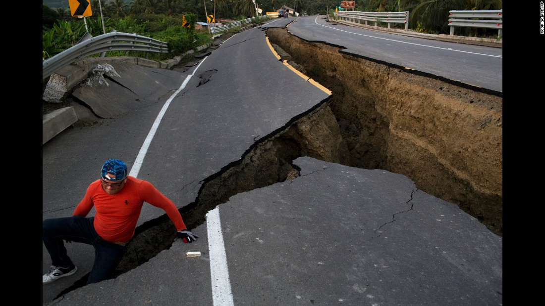 "<strong>April 19:</strong> A man in Chacras, Ecuador, investigates a road that collapsed after <a href=""http://www.cnn.com/2016/04/20/americas/ecuador-earthquake/"" target=""_blank"">a 7.8-magnitude earthquake.</a> It was the strongest earthquake to hit Ecuador in decades. Hundreds of people were killed."