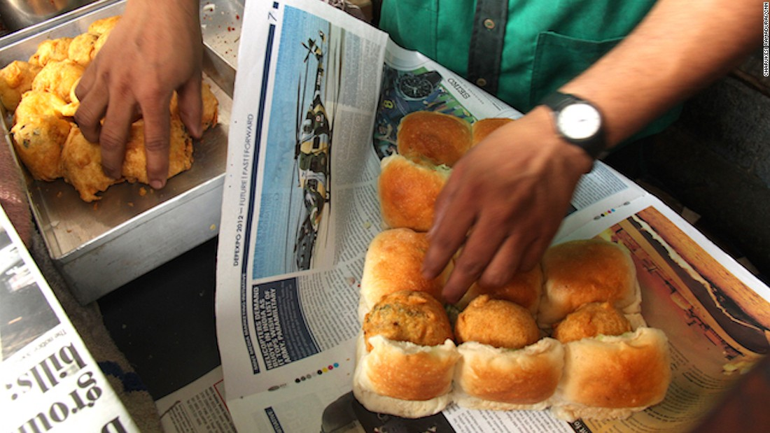 This home-grown version of the veggie burger is probably Mumbai's favorite street snack. A plump and warm fried vada (potato patty) is placed inside a pav (thick bun) that's been sliced open and smeared with fiery garlic and chilli chutney.