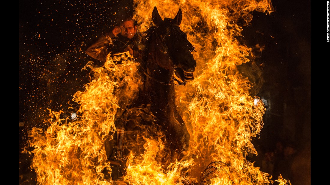 <strong>January 16:</strong> A horseman jumps over a bonfire during the annual Las Luminarias festival in San Bartolome de Pinares, Spain. In honor of Anthony the Abbot, the patron saint of animals, horses are traditionally ridden through bonfires to purify and protect them in the year ahead.
