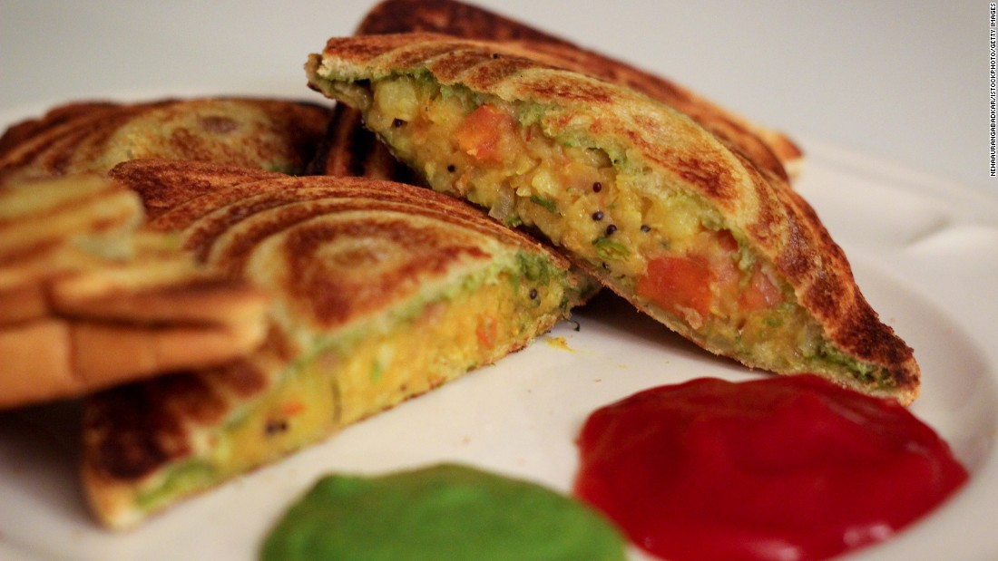This Mumbai classic features a generous smearing of green chutney, fresh veggies and  (sometimes) crumbled cottage cheese. It's grilled to golden perfection on a small hand-held toaster.