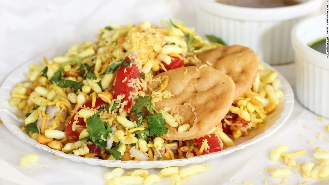 Versions of this popular dish can be found throughout India. Mumbai's rendition is made of puffed rice, sev (a thin and crisp fried snack made of chickpea flour), boiled potato, raw mango and onions. It's topped with fresh coriander and two or three chutneys.