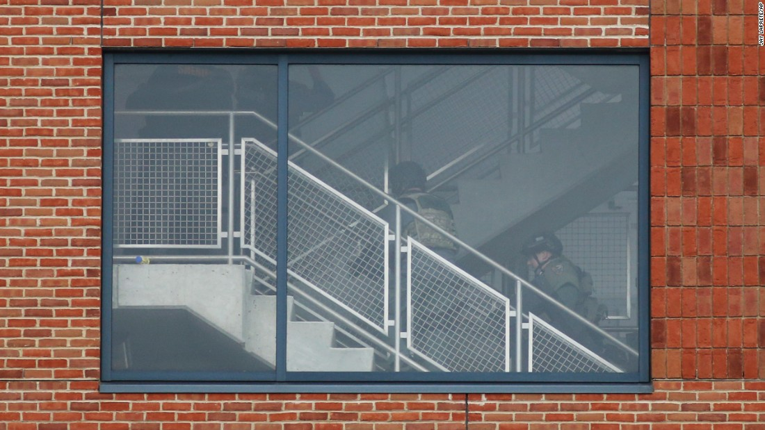 "SWAT team members walk up the steps of a parking garage after <a href=""http://www.cnn.com/2016/11/28/us/ohio-state-university-active-shooter/index.html"" target=""_blank"">an attack on the campus of Ohio State University</a> on Monday, November 28. Authorities said Abdul Razak Ali Artan, an 18-year-old student, rammed his car into a group of pedestrians before using a butcher knife to cut several people. At least 11 people were hospitalized. Artan was fatally shot by a campus police officer."