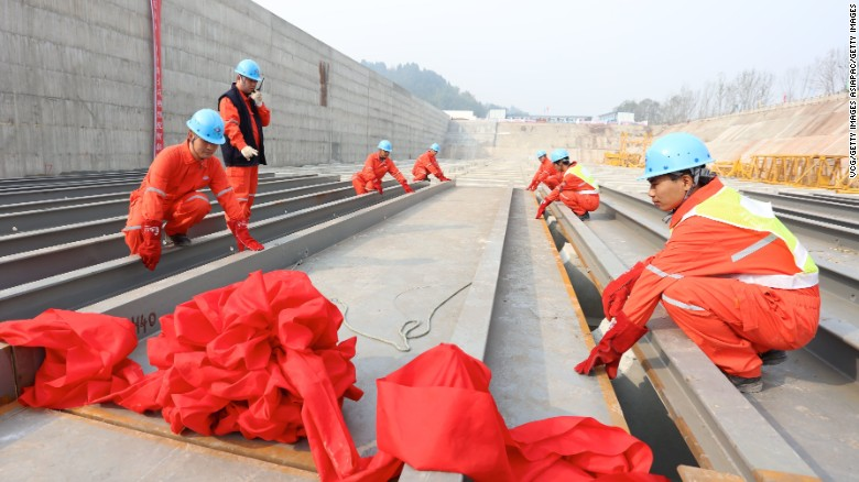 Workers lay the keel of a replica Titanic in China's Sichuan province.