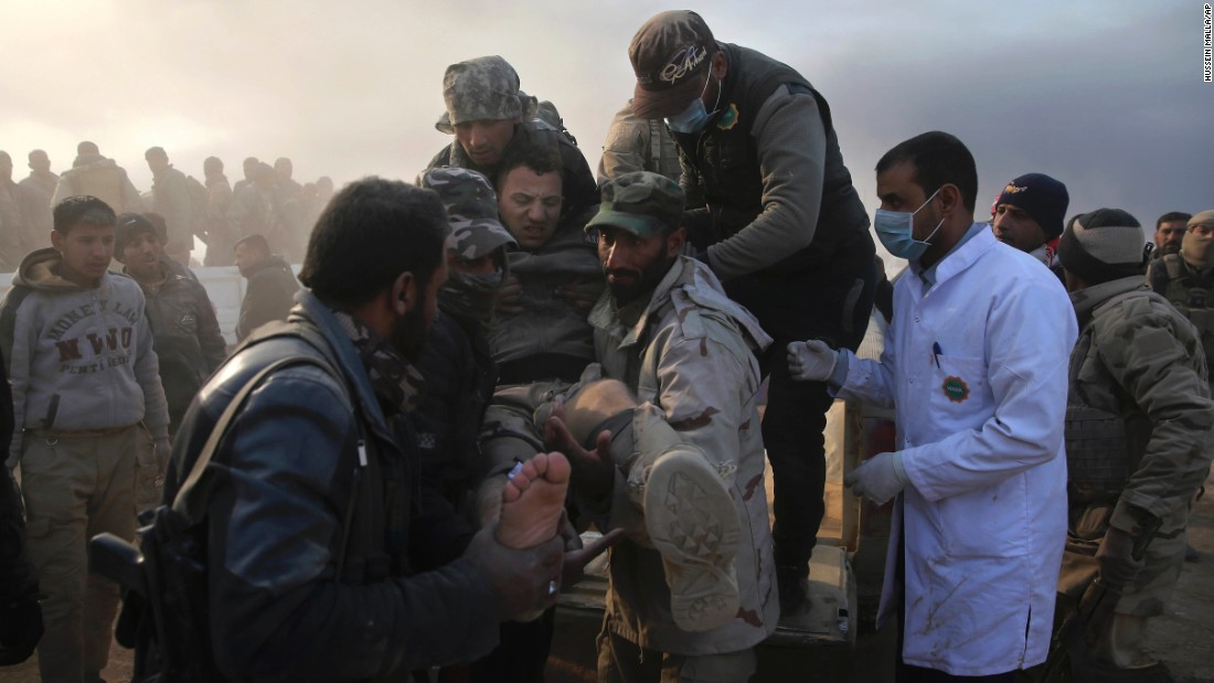 "Iraqi army soldiers carry a wounded comrade in Mosul, Iraq, on Tuesday, November 29. An offensive <a href=""http://www.cnn.com/2016/10/17/world/gallery/mosul/index.html"" target=""_blank"">began in October</a> to reclaim Mosul, Iraq's second-largest city and the last major stronghold for ISIS in the country."