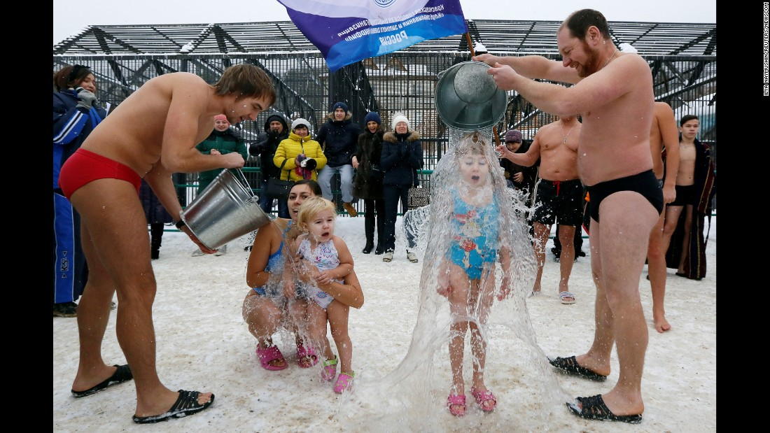 Members of a winter swimmers club pour cold water on two girls during a Polar Bear Day celebration at a zoo in Krasnoyarsk, Russia, on Sunday, November 27. The temperature was minus-5 degrees Celsius (23 degrees Fahrenheit).