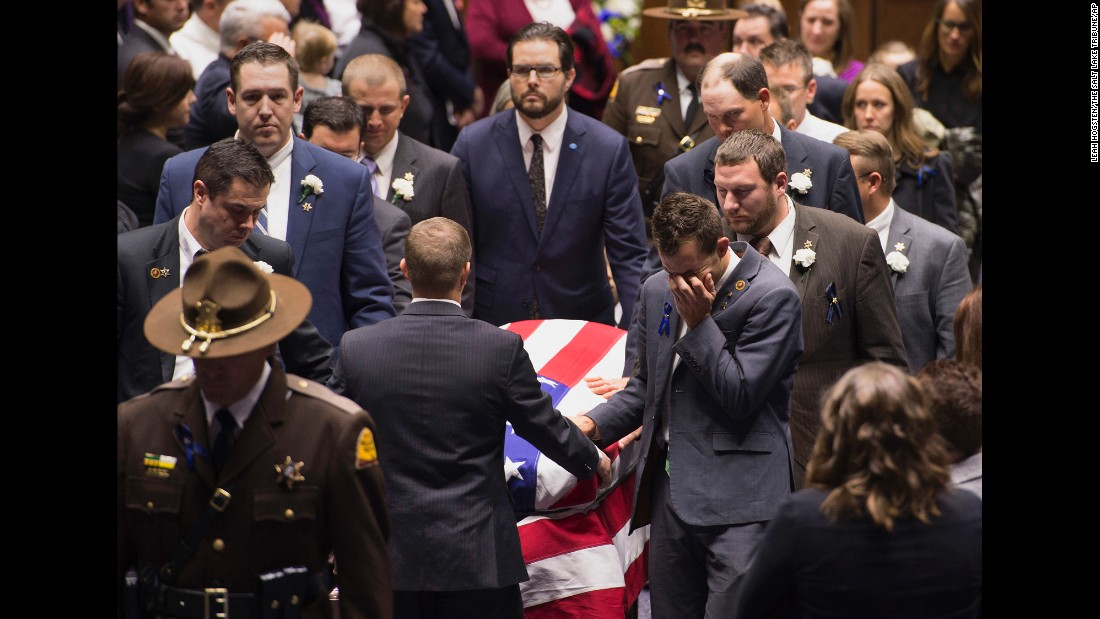 "Mike Ellsworth weeps as he and his family members transport the casket of his brother, Utah Highway Patrol Trooper Eric Ellsworth, at a funeral service in Ogden, Utah, on Wednesday, November 30. Eric Ellsworth, 31, <a href=""http://www.sltrib.com/news/4634501-155/public-funeral-for-utah-trooper-eric"" target=""_blank"">died days after he was struck by a car</a> while on duty."