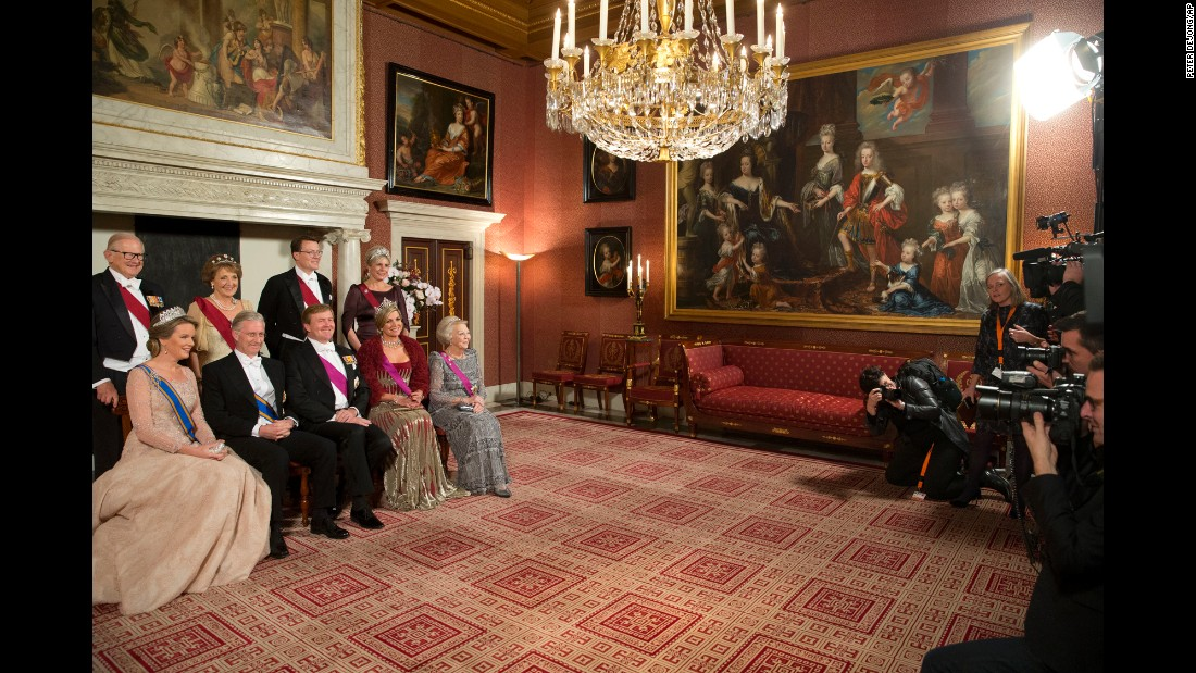 Belgium's King Philippe and Queen Mathilde are seated on the left next to Dutch King Willem-Alexander and Queen Maxima as they pose with other members of the Dutch royal family on Monday, November 28. The photos were taken at the royal palace in Amsterdam, Netherlands.