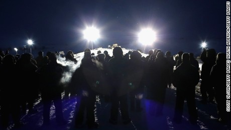 CANNON BALL, ND - NOVEMBER 30:  Military veterans, most of whom are native American, confront police guarding a bridge near Oceti Sakowin Camp on the edge of the Standing Rock Sioux Reservation on November 30, 2016 outside Cannon Ball, North Dakota. Native Americans and activists from around the country have been gathering at the camp for several months trying to halt the construction of the  Dakota Access Pipeline. The proposed 1,172 mile long pipeline would transport oil from the North Dakota Bakken region through South Dakota, Iowa and into Illinois.  (Photo by Scott Olson/Getty Images)
